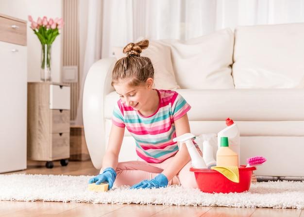 Maid brushing carpet