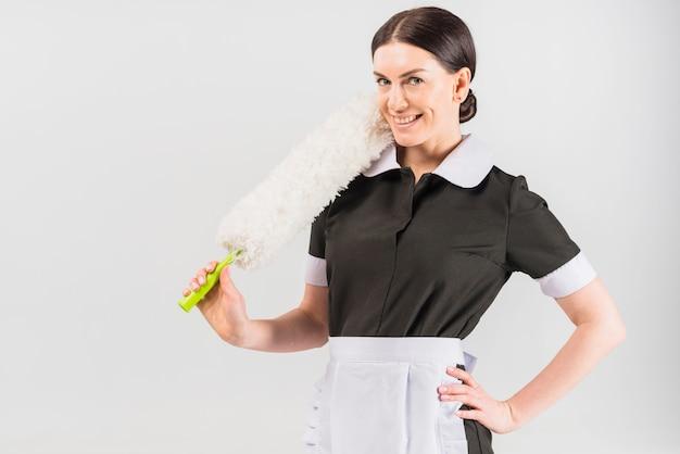 Maid in uniform smiling