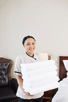 Maid with towels at hotel