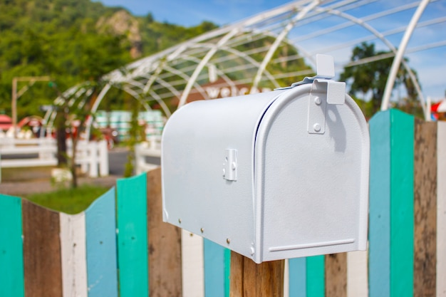 Mail boxes and an antique farm implement in a farming landscape