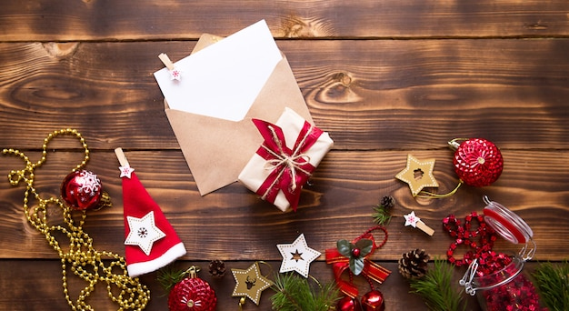Mail envelope with a white sheet for text on a wooden table with christmas decor