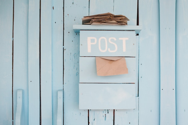 Mailbox with letters in vintage style on wooden blue