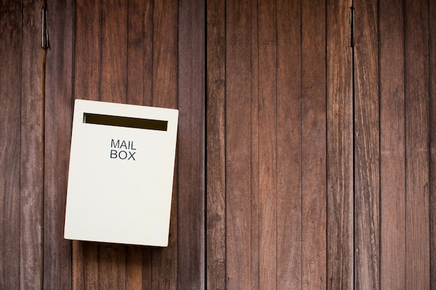 Mailbox on wood background