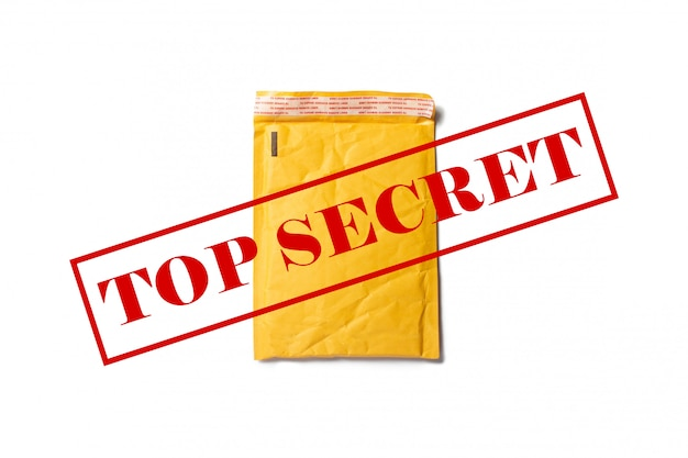 A mailing paper bag for letters or small parcels with text top secret on a light space. top secret information .flat lay, top view