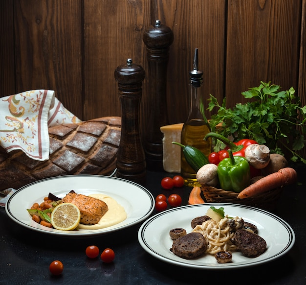 Main dishes with fish and meat and a wicker basket of vegetables