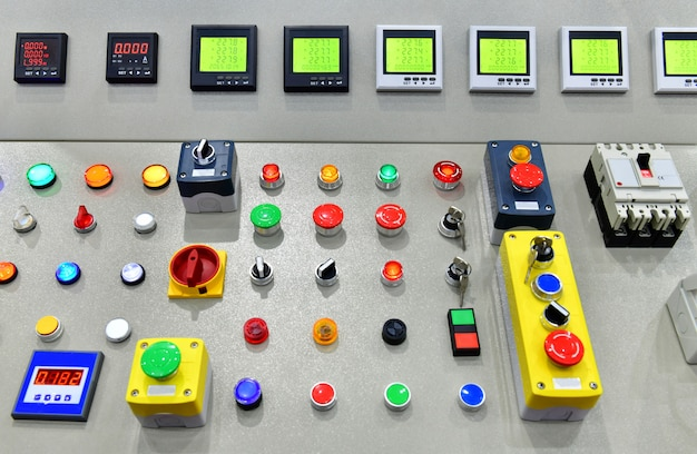 Main electronic power control switch system and button at industrial factory.