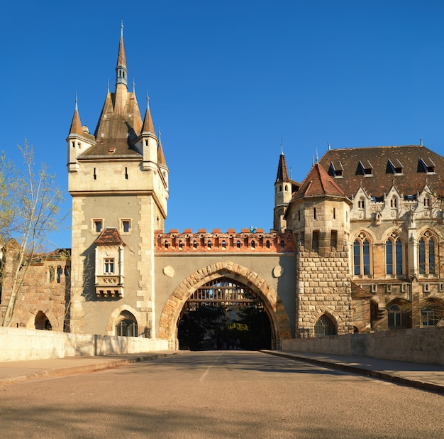 Main gate to vajdahunyad castle on a bright day in budapest