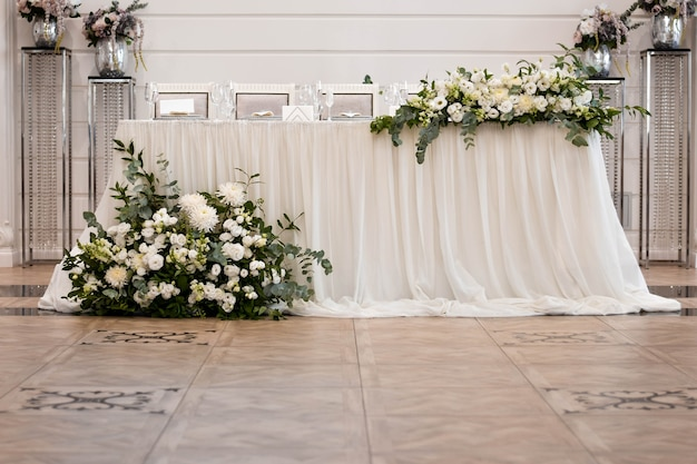 Main table at a wedding reception with beautiful fresh flowers. wedding day.