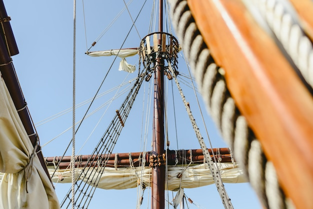 Mainmast and rope ladders to hold the sails of a sailboat.