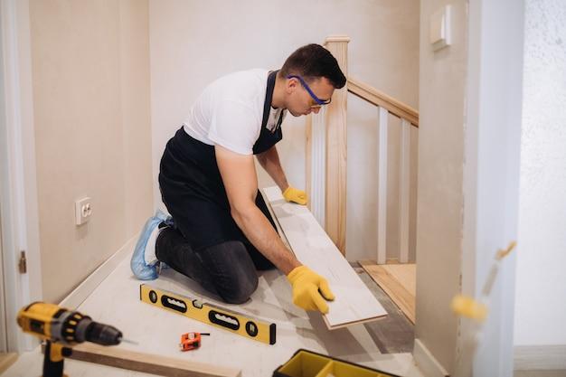 Maintenance man fixing a new floor