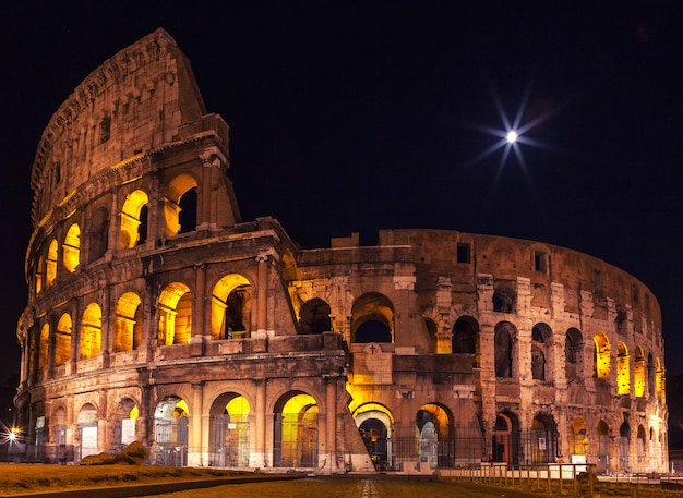 The majestic coliseum in the night illumination.