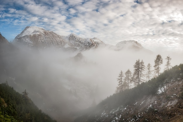 Majestic landscape with mountain, fog and clouds