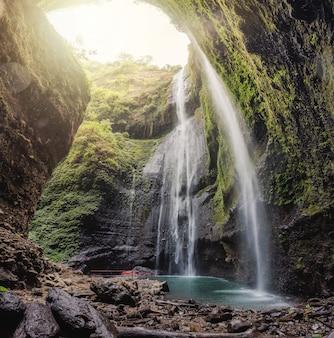 Majestic madakaripura waterfall flowing in tropical rainforest