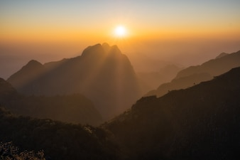 Majestic sunset in the mountains landscape with sunny beams