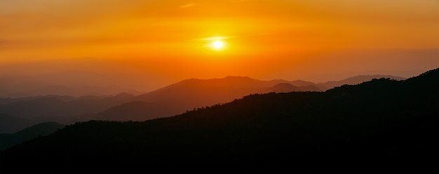 Majestic sunset sky over the mountains landscape