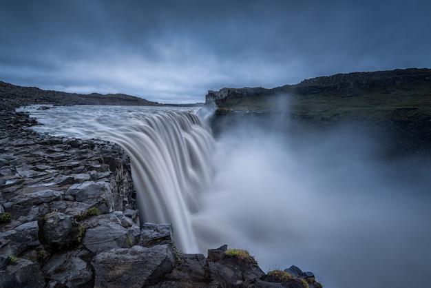 Majestic waterfalls on rocky environment