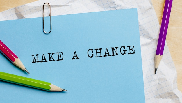Make a change text written on a paper with pencils