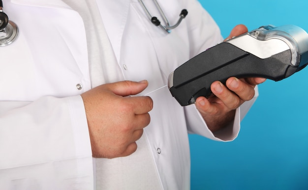 Make purchase with the credit card pharmacist stretching out a credit card looking