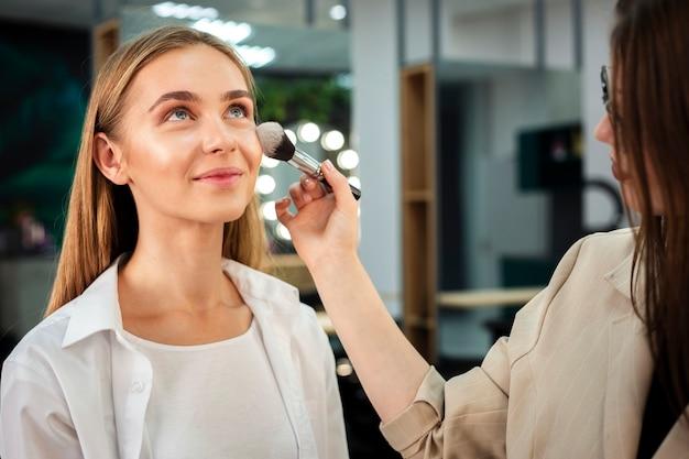 Make-up artist applying fixing powder