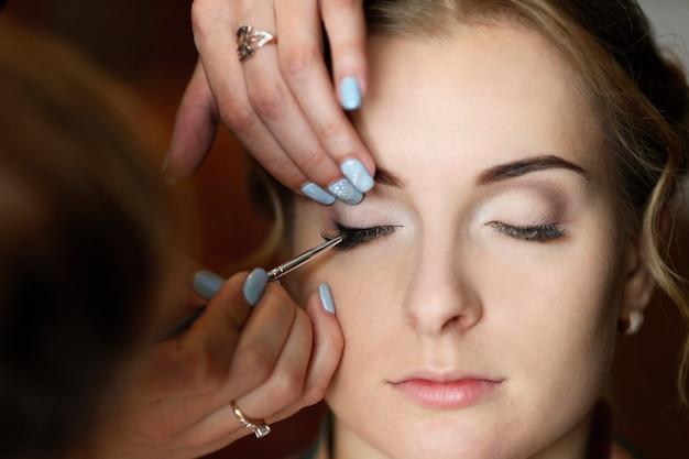Make-up artist doing makeup.make up
