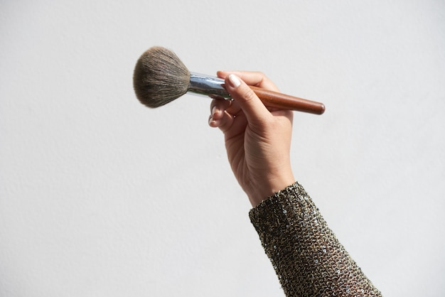 Make-up artist with powder brush