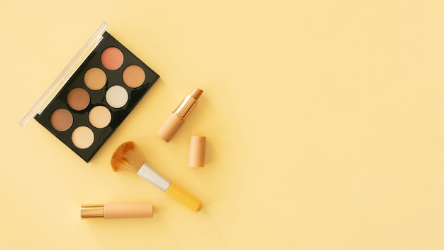 Make up beauty products and bag with copy-space