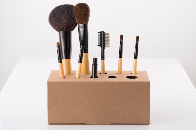 The make up brush in storage on table