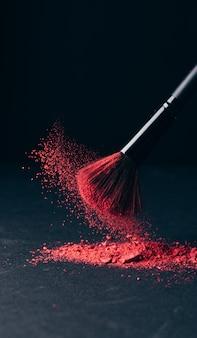 Make-up brush with powder explosion