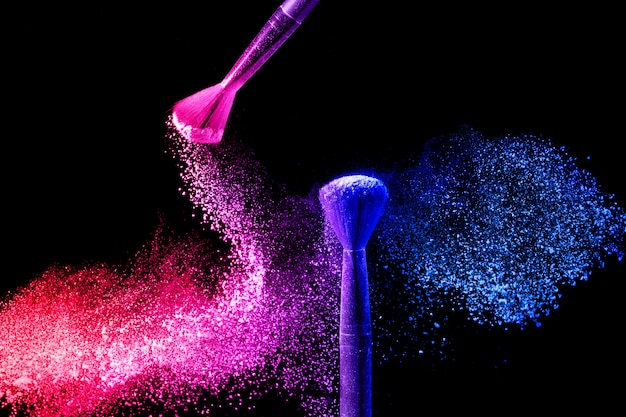 Make-up brushes with blue and pink powder splash.