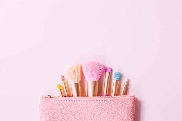 Make up brushes with powder on white background