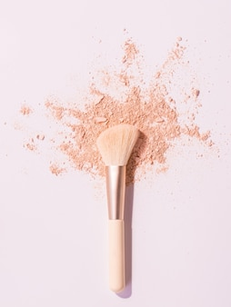 Make up brushes with powder on white space