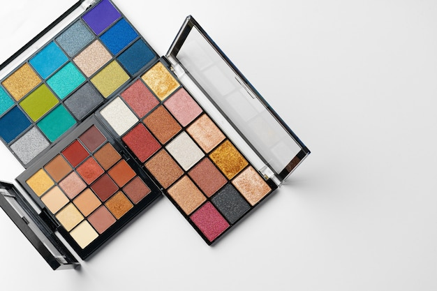 Make up colorful eyeshadow palettes isolated on white, top view