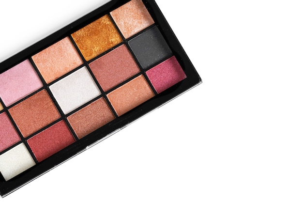 Make up colorful eyeshadow palettes on white, close up
