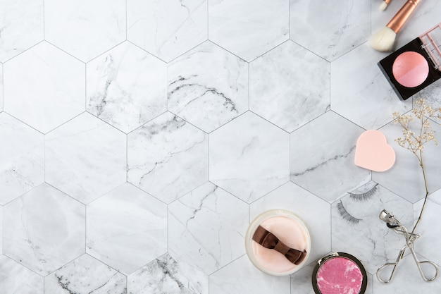 Make up cosmetic flat lay top view on the tile marble white color look clean
