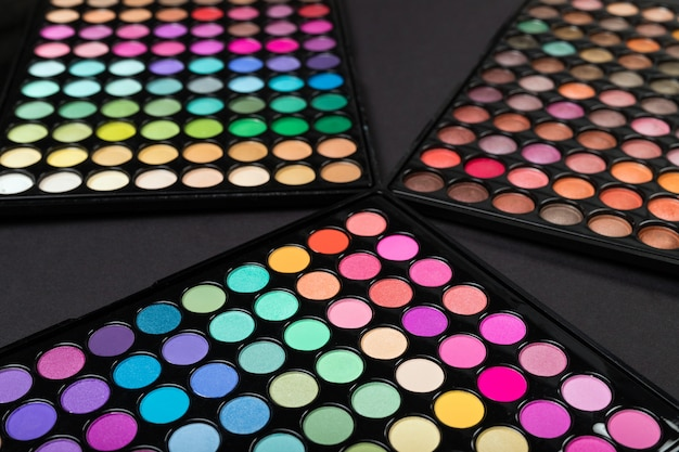 Make-up eyshadow palettes on a black space