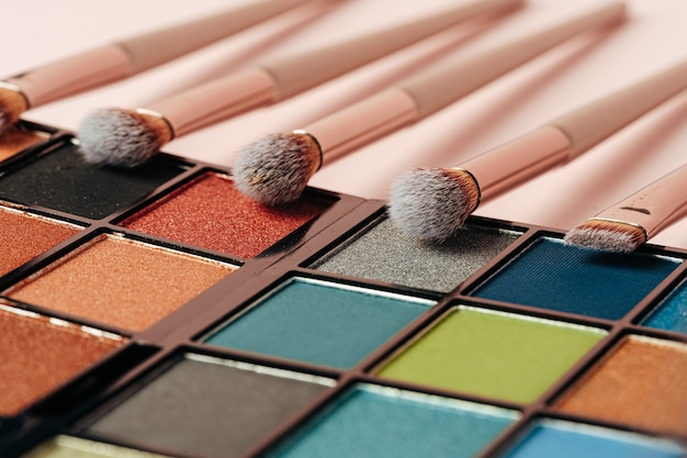 Make-up palette and brushes. professional eyeshadow palette. close up.