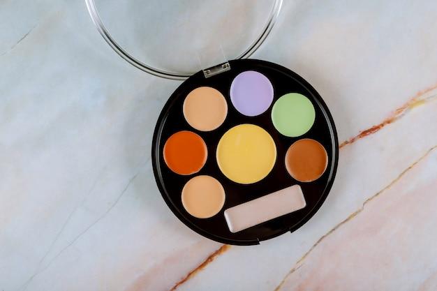 Make up palette, eye shadows in black box.