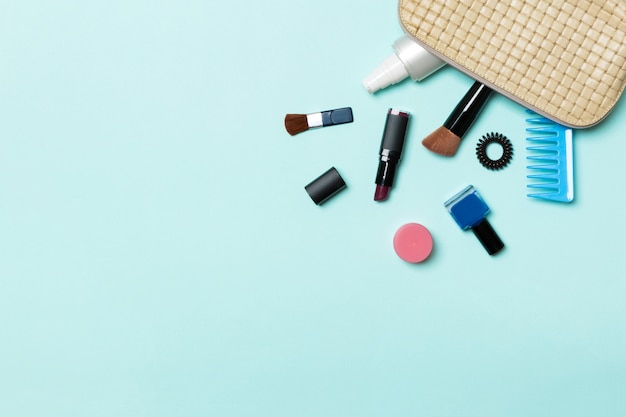 Make up products fallen out of cosmetics bag