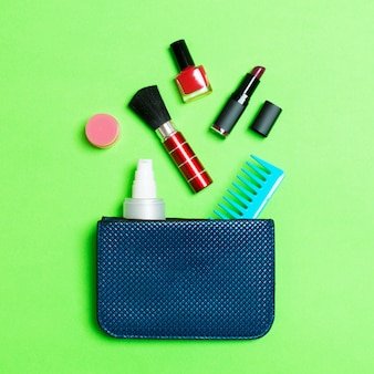Make up products spilling out of cosmetics bag