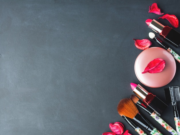 Make up products and tools with pink petals