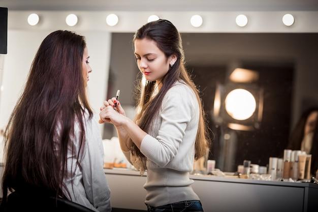 Makeup artist apply makeup