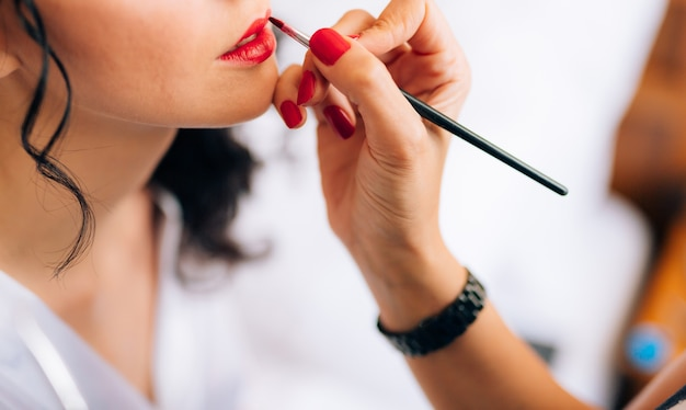 Makeup artist making a make up for bride beautiful sexy