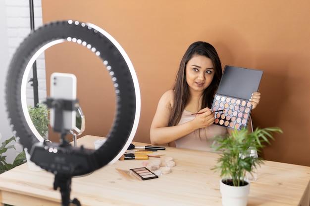 Makeup artist vlogging her tutorials