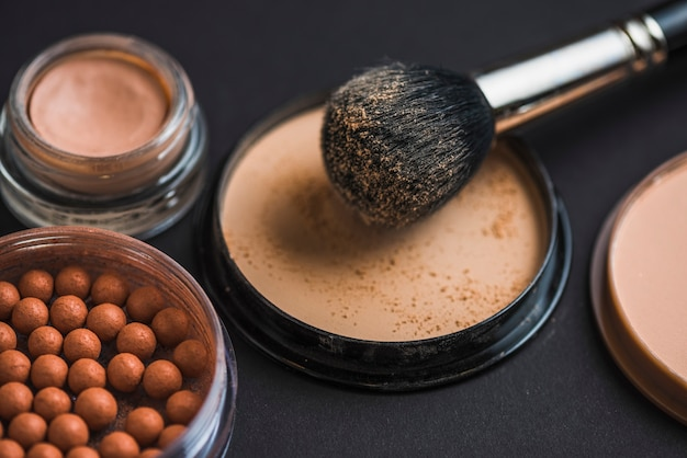 Makeup brush on compact powder with bronzing pearls
