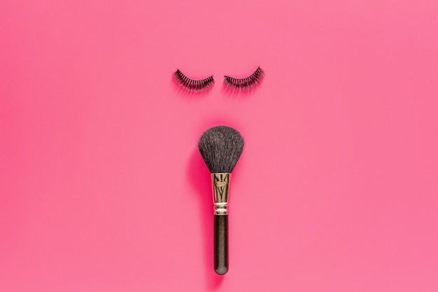 Makeup brush and false eyelashes