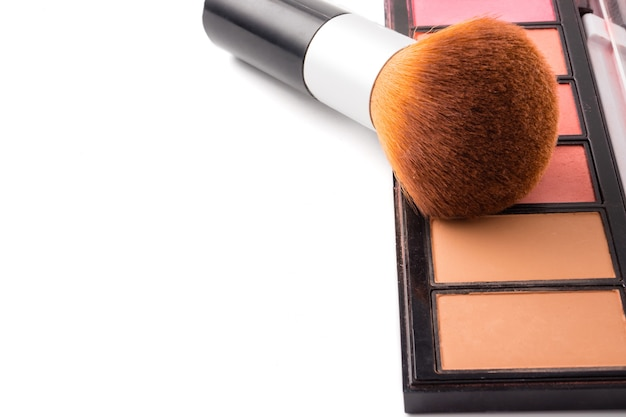 Makeup brush and palette on white background, free space for text.