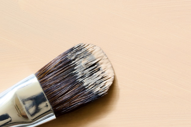 Makeup brush on smudged nude foundation
