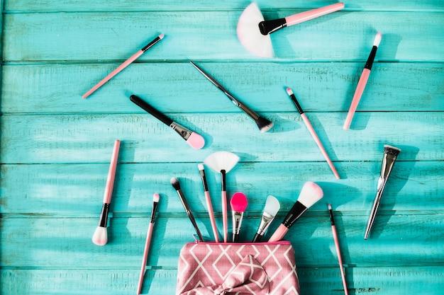 Makeup brushes near cosmetics bag