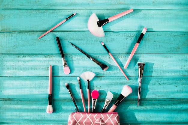 Makeup brushes in pink cosmetics bag