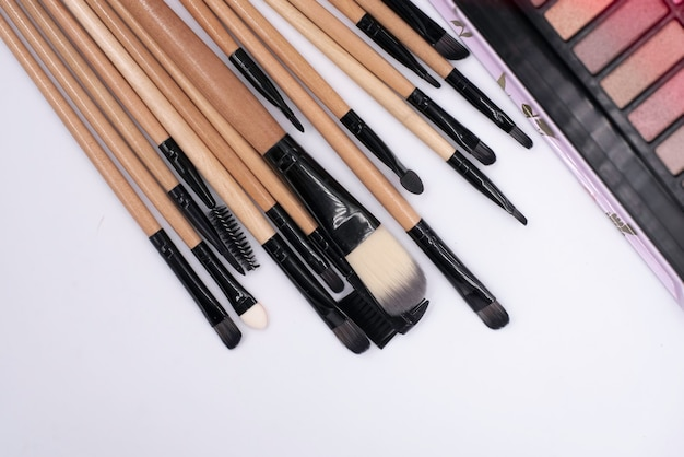 Makeup brushes put on background,cosmetic tool,blurry light around